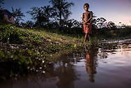 Doctors and nurses from the Igaraçu visit homes in the indigenous communities Monday Amazon river, aka Rio Madeira June 16, 2015. Photo Ken Cedeno