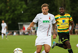 26.07.2015, Prien am Chiemsee, GER, Testspiel, FC Augsburg vs Norwich City, im Bild Alexander Esswein (FC Augsburg #11), hinten Sebastien Bassong (Norwich City). // during the International Friendly Football Match between FC Augsburg and Norwich City in Prien am Chiemsee, Germany on 2015/07/26. EXPA Pictures © 2015, PhotoCredit: EXPA/ Eibner-Pressefoto/ Krieger<br /> <br /> *****ATTENTION - OUT of GER*****