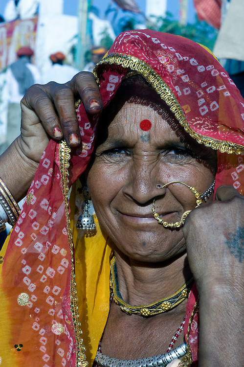 Many Rajasthani women from the Thar desert, wear beautiful jewels and colourful clothes.
