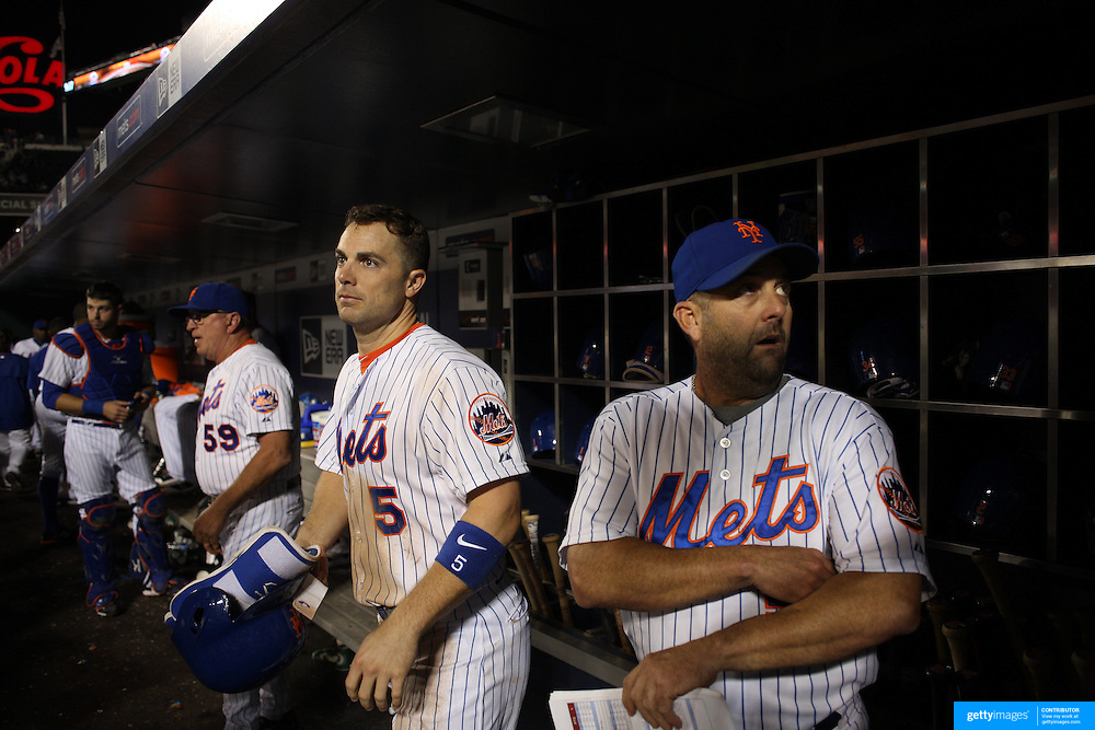 David Wright, (left), New York Mets, with hitting coach Kevin Long, preparing to bat in the dugout during the New York Mets Vs Atlanta Braves MLB regular season baseball game at Citi Field, Queens, New York. USA. 22nd September 2015. Photo Tim Clayton