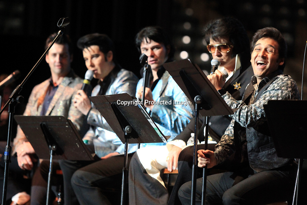 Cote Deonath, this years winner of the Elvis Tribute Artist Competition, laughs during a performance with other Elvis Tribute Artists during the Gospel Concert held Sunday morning at the BancorpSouth Arena in Tupelo.