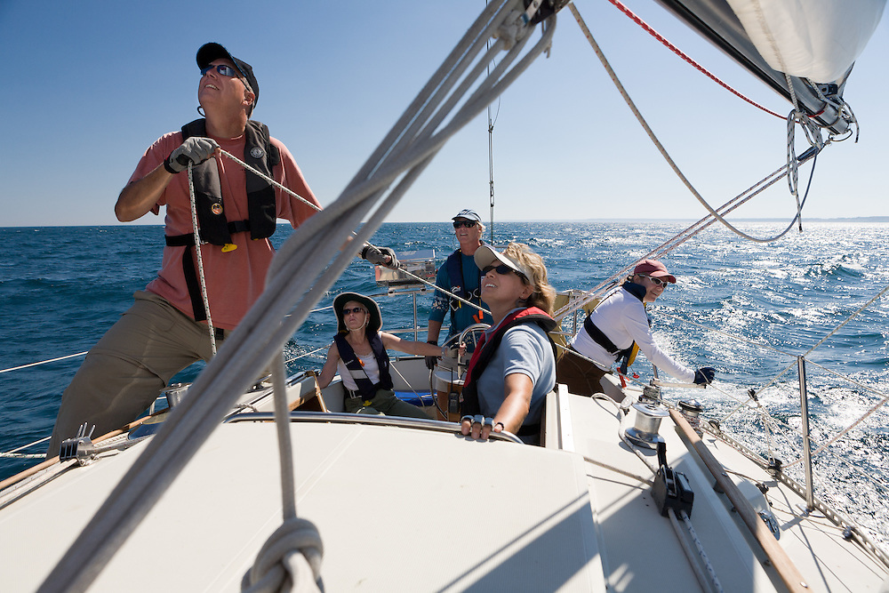 Tom French and crew manage the spinnaker while daysailing on Lake Michigan.