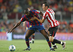 FC Barcelona's Toure Yaya (l) and Athletic de Bilbao's Igor Gabilondo during the Supercup of Spain.August 23 2009.