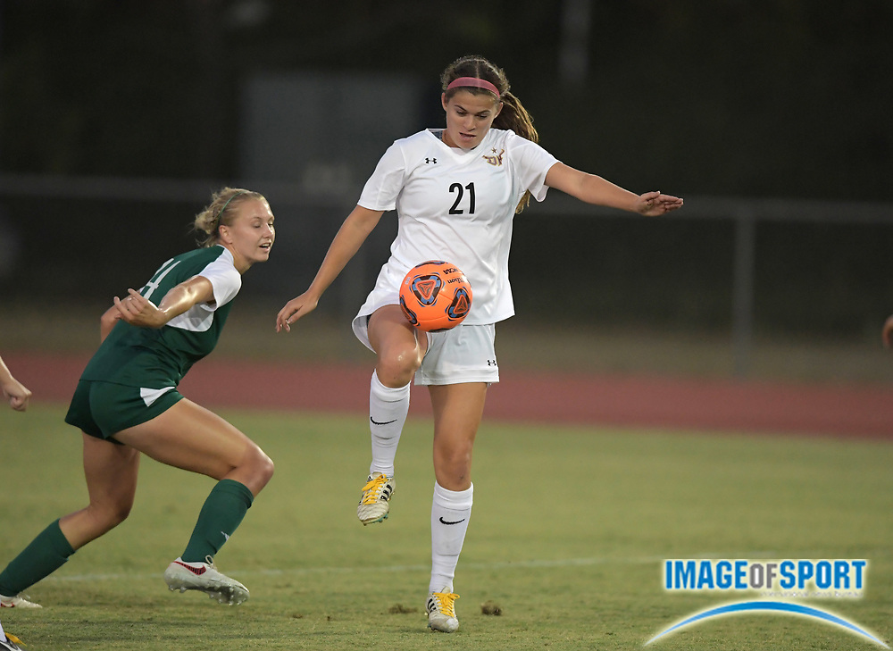 Cal State Dominguez Hills midfielder Katrina Cohen (21) and Concordia Eagles forward Megan Hussey (4) battle for the ball during a nonconference women's soccer match against the Concordia Eagles in Carson, Calif. on Friday, September 8, 2017. Concordia defeated CSUDH 3-1.