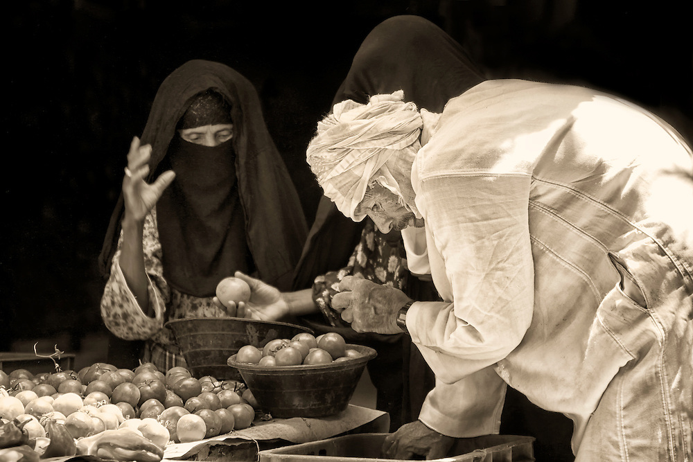 Berber women and man at the market in Rissani, Morocco.