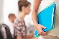 Businesswoman carrying Folder mid section close-up