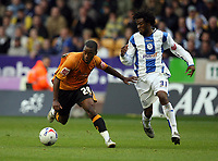 Photo: Rich Eaton.<br /> <br /> Wolverhampton Wanderers v Sheffield Wednesday. Coca Cola Championship. 28/10/2006. Rohan Ricketts left of Wolves and Wednesdays Yoann Foley clash