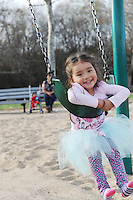 Yamilet Moreno, 3, just hangin' out on the swings at Natividad Creek Park on Sunday in Salinas.