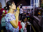 29 MAY 2018 - BANGKOK, THAILAND: A woman prays during Vesak observances at Wat Hua Lamphong in Bangkok. Vesak is the Buddha's birthday, and one of the most important holy days in the Theravada Buddhist religion. Many Thais visit their local temples for Vesak and rededicate themselves to the Dharma, listen to talks about Buddhism and make merit by bringing flowers to the temple.        PHOTO BY JACK KURTZ