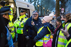 London, UK. 13th March, 2019. A pro-Brexit Yellow Vests UK activist is released after being questioned by the Metropolitan Police in Westminster on the evening of the vote on a 'No Deal' Brexit in the House of Commons.