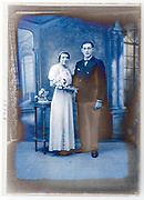 deteriorating wedding portrait in studio with classic interior background France circa 1920s