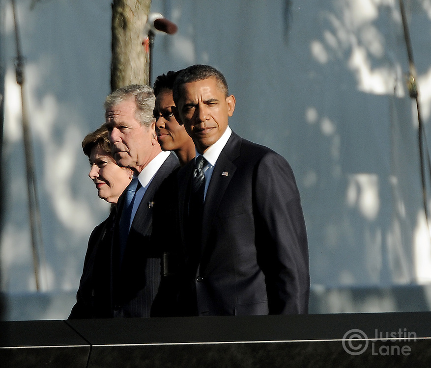 United States President Barak Obama (R), First Lady Michelle Obama (2nd R) and former President George W. Bush (2nd L) and former First Lady Laura Bush (L) walk past the North Pool of the 9/11 Memorial during tenth anniversary ceremonies at the site of the World Trade Center September 11, 2011, in New York. POOL/Justin Lane/EPA