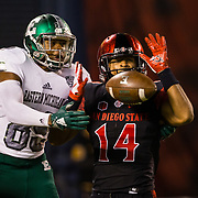 22 September 2018: San Diego State Aztecs safety Tariq Thompson (14) breaks up a pass in the end zone to Eastern Michigan Eagles wide receiver Arthur Jackson III (89) in the second quarter. The San Diego State Aztecs beat the Eastern Michigan Eagles 23-20 in over time at SDCCU Stadium in San Diego, California.