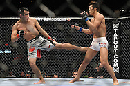 "LAS VEGAS, NEVADA, MAY 24, 2008: Jason Tan (left) throws a kick to the leg of Dong Hyun Kim during ""UFC 84: Ill Will"" inside the MGM Grand Garden Arena in Las Vegas"
