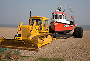 New fishing boat and yellow bulldozer on the beach, Aldeburgh, Suffolk, England