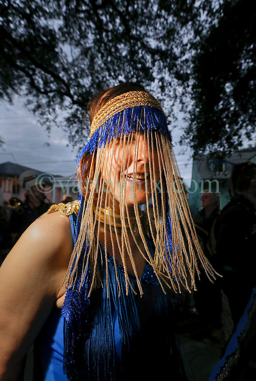 30 January 2016. New Orleans, Louisiana.<br /> A parader heads at the the mico-Krewe of 'Tit Rex' parade in the Bywater and Marigny. All the floats are scaled down versions of the current parade giant with a shoe box at their base. The theme for this year's parade was 'No Big Deal.' <br /> Photo©; Charlie Varley/varleypix.com