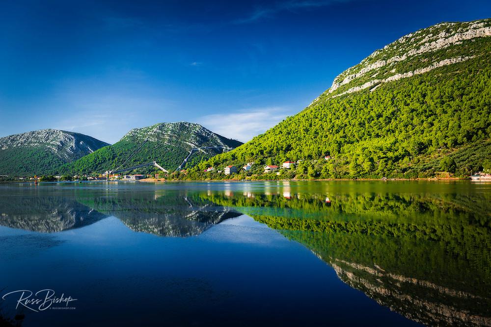 Adriatic reflection and the Great Wall above the city center, Ston, Dalmatian Coast, Croatia