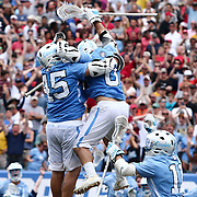 North Carolina Attackman CHRIS CLOUTIER (45), left, celebrates with teammates after scoring the game winning goal in overtime of The NCAA Division I NATIONAL CHAMPIONSHIP GAME between North Carolina and Maryland, Monday, May. 30, 2016 at Lincoln Financial Field in Philadelphia, Pa