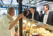 "© Licensed to London News Pictures. 13/04/2015. Carshalton, UK. Nick Clegg (L) and Tom Brake talk to staff at ""Bakery"" on Carshalton High Street.  Leader of the Liberal Democrats and Deputy Prime Minister Nick Clegg visits Carshalton and Wallington constituency on Monday (13th April) with Lib Dem candidate Tom Brake.  Photo credit : Stephen Simpson/LNP"
