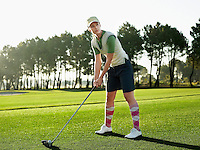 Young female golfer teeing off