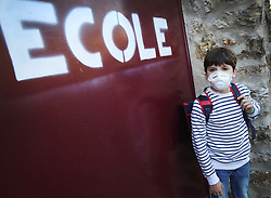 This illustration picture shows a pupil wearing a mask in front of his school in Montreuil-sous-Bois Bois near Paris, France on April 22, 2020, as children are planned to resume school in France on May 11 after 6 weeks under lockdown due to Coronavirus Covid-19 pandemic. The first pupils to return will be the 5-7-year-olds as well as those in their final year of primary school. The following week they'll be joined by 11-12 year olds, 14-15 year olds and 16-18 year olds. Photo by Jerome Domine/ABACAPRESS.COM