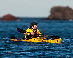 Richard Harpham. Scottish Sun sports editor Iain King tales part in a practise session for his charity kayak challenge, in the waters of the harbour at St Abbs..Pic © Michael Schofield...