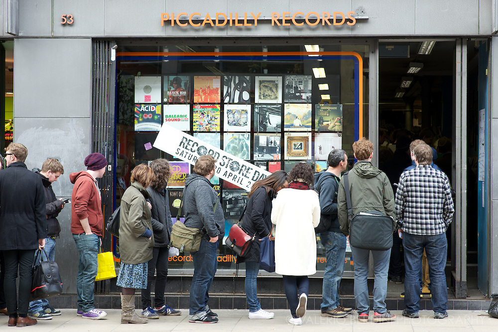 People queue at the opening of Record Store Day 2013 at Piccadilly Records store in Manchester UK.