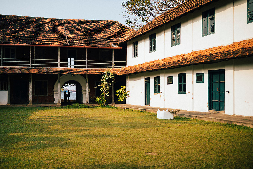 Fort Kochi, India -- February 12, 2018: The grounds of the Pepper House cafe, in an old warehouse area on the water in Mattancherry.