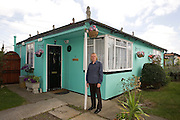 Jim in front of his prefab at the Excalibur estate in Catford, South London. He has been living in his prefab for 20 years and is fighting to save it as the Lewisham Council want to pull the prefabs down. It was in 2009, now Jim has lost the battle and lives in Kent