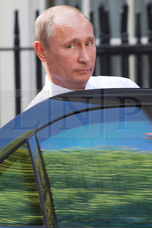 © licensed to London News Pictures. London, UK 16/06/2013. Russian President Vladimir Putin leaving Downing Street after talks with David Cameron ahead of the G8 summit on Sunday, 16 June 2013. Photo credit: Tolga Akmen/LNP