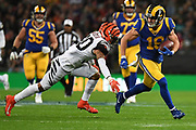 Cincinnati Bengals Defensive Back Jessie Bates III (30)  comes in to tackle LA Rams Wide Receiver Cooper Kupp (18) during the International Series match between Los Angeles Rams and Cincinnati Bengals at Wembley Stadium, London, England on 27 October 2019.