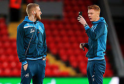 Sam Clucas of Swansea City films Oliver McBurnie on the pitch before kick off - Mandatory by-line: Matt McNulty/JMP - 26/12/2017 - FOOTBALL - Anfield - Liverpool, England - Liverpool v Swansea City - Premier League