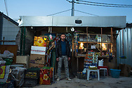 Saad Waad, 25, owns the shop for 1,5 years. Lives outside the camp. spent 5-6 million dinar in the shop. Back in Qaraqosh he used to run a big chicken farm.