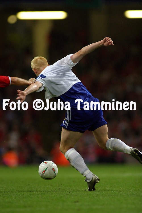 10.09.2003, Millenium Stadium, Cardiff, Wales..UEFA European Championship Qualifying match, Wales v Finland..Mikael Forssell (Finland) nearly has his shirt pulled off by Andy Melville (Wales).©Juha Tamminen