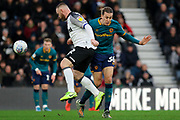 Hull City midfielder Jackson Irvine and Derby County forward Wayne Rooney collide during the EFL Sky Bet Championship match between Derby County and Hull City at the Pride Park, Derby, England on 18 January 2020.