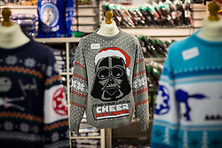 "© Licensed to London News Pictures . 06/12/2015 . Manchester , UK . Star Wars Christmas jumpers for sale . Fans attend Star Wars exhibition "" For the Love of the Force "" at Bowlers Exhibition Centre in Manchester . Photo credit : Joel Goodman/LNP"