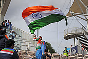 An fan waves a big Indian flag ahead of the ICC Cricket World Cup 2019 match between South Africa and India at the Hampshire Bowl, Southampton, United Kingdom on 5 June 2019.