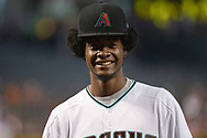 PHOENIX, AZ - JUNE 23:  Josh Jackson of the Phoenix Suns wears an Arizona Diamondbacks cap and jersey while throwing out the ceremonial first pitch for the Philadelphia Phillies and Arizona Diamondbacks MLB game at Chase Field on June 23, 2017 in Phoenix, Arizona. Jackson is the Phoenix Suns 2017 first-round draft pick.  (Photo by Jennifer Stewart/Getty Images)