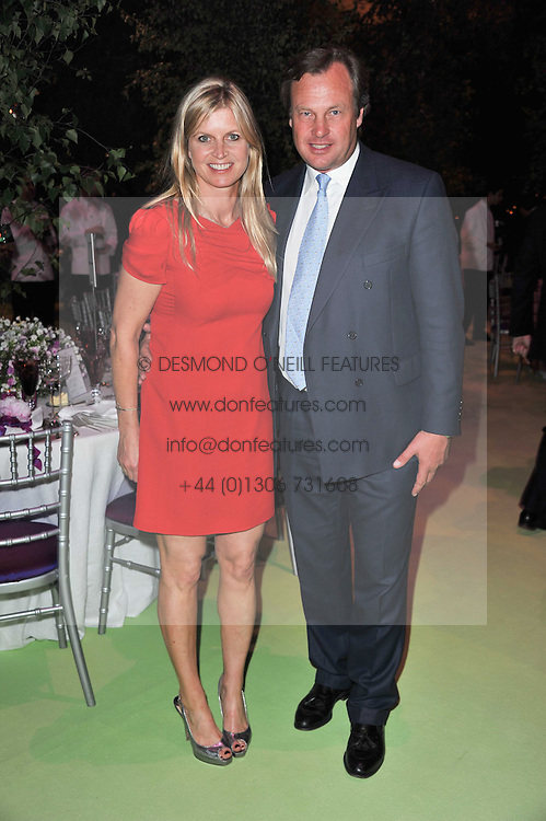 The MARQUESS & MARCHIONESS OF MILFORD HAVEN at a dinner hosted by Cartier in celebration of the Chelsea Flower Show held at Battersea Power Station, 188 Kirtling Street, London SW8 on 23rd May 2011.