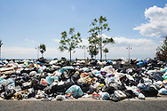 ITALY, NAPLES : Piles of uncollected garbage are seen in Pozzuoli, a suburb of Naples, on May 9, 2011. Garbage has been accumulating on the streets of the the souther italian city for the last weeks. The italian government sent the army in order to face this nes emergency..AFP PHOTO / ROBERTO SALOMONE