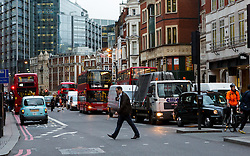© Licensed to London News Pictures. 22/12/2015. London, UK. The rush hour begins early as traffic queues in the City of London near Liverpool Street station. Today is the start of the annual festive Christmas getaway, which combined with last minute shopping and regular commuting is expected to lead to packed trains and congested roads across the country. Photo credit : Vickie Flores/LNP