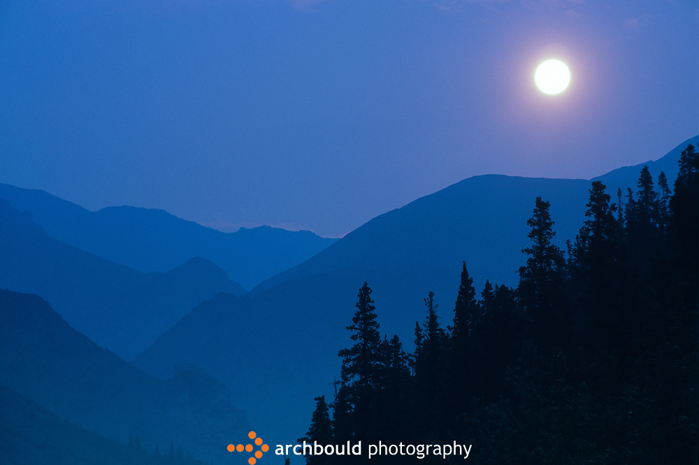 Moon over the mountains in the Yukon