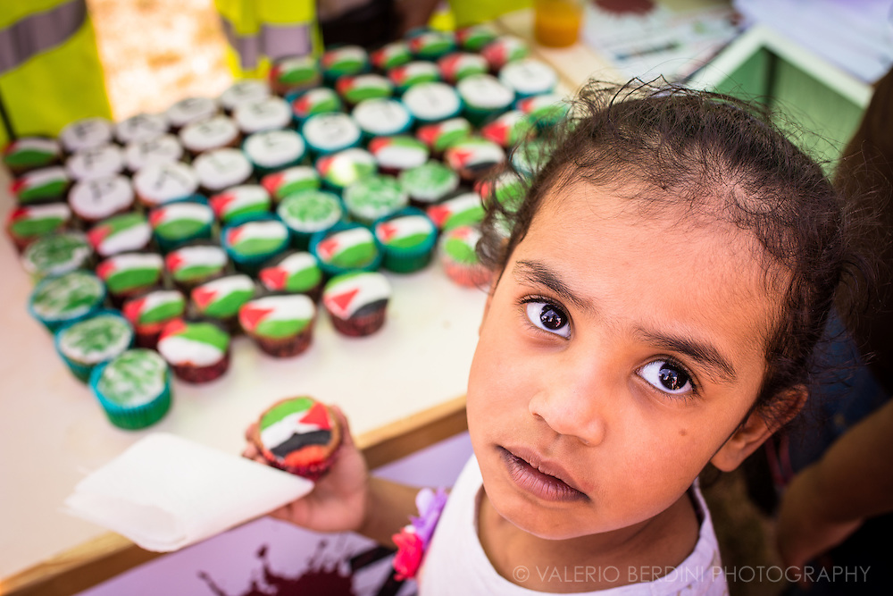 A girl picks her favourite cupcake. Stop the massacre in Gaza. 150.000 thousands people march in the streets of Central London to Hyde Park ask the end of Israeli invasion of Gaza. 9 August 2014