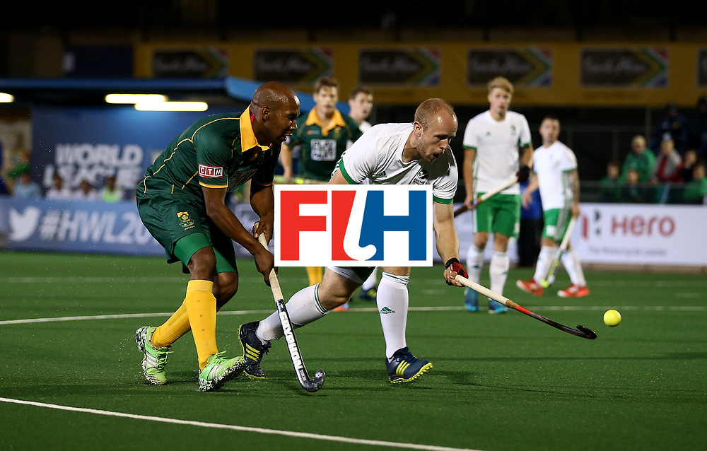 JOHANNESBURG, SOUTH AFRICA - JULY 09:  Eugene Magee of Ireland battles with Julian Hykes of South Africa during day 1 of the FIH Hockey World League Semi Finals Pool B match between South Africa and Ireland at Wits University on July 9, 2017 in Johannesburg, South Africa.  (Photo by Jan Kruger/Getty Images for FIH)