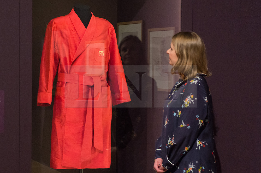 © Licensed to London News Pictures. 03/04/2017. Museum staff views Noel Coward's Dressing Gown worn during his play The Vortex showing as part of Tate Britain's Queer British Art exhibition. London, UK. Photo credit: Ray Tang/LNP