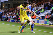 AFC Wimbledon striker Andy Barcham (17) and Peterborough United midfielder Chris Forrester (8) during the EFL Cup match between Peterborough United and AFC Wimbledon at ABAX Stadium, Peterborough, England on 9 August 2016. Photo by Stuart Butcher.
