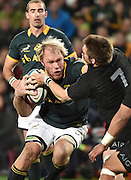 JOHANNESBURG, South Africa, 25 July 2015 : Schalk Burger (C) of the Springboks tries to hand off Richie McCaw (C) of the All Blacks  during the Castle Lager Rugby Championship test match between SOUTH AFRICA and NEW ZEALAND at Emirates Airline Park in Johannesburg, South Africa on 25 July 2015. Bokke 20 - 27 All Blacks<br /> <br /> © Anton de Villiers / SASPA