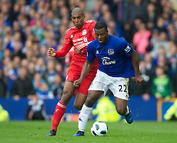 LIVERPOOL, ENGLAND - Sunday, October 17, 2010: Liverpool's Ryan Babel and Everton's Ayegbeni Yakubu during the 214th Merseyside Derby match at Goodison Park. (Photo by David Rawcliffe/Propaganda)