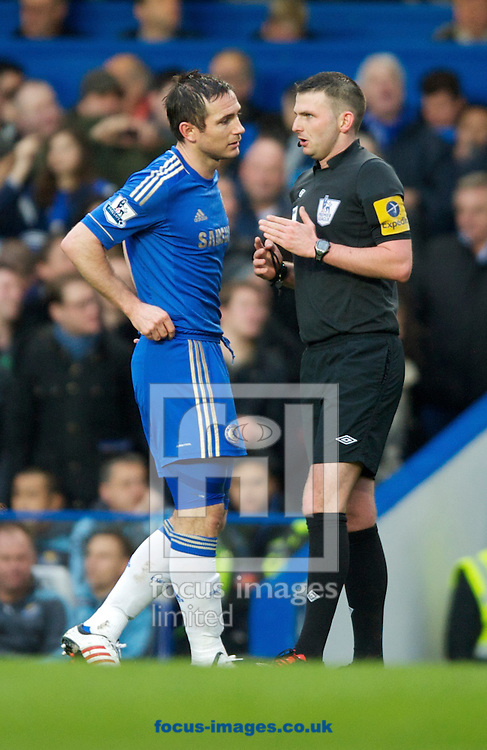 Picture by Alan Stanford/Focus Images Ltd +44 7915 056117.17/03/2013.Referee Michael Oliver speaks to Frank Lampard of Chelsea after he celebrates his 200th goal during the Barclays Premier League match at Stamford Bridge, London.