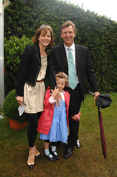 DARCEY BUSSELL and her husband ANGUS FORBES with their eldest daughter PHOEBE at the Cartier Style Et Luxe at the Goodwood Festival of Speed, Goodwood House, West Sussex on 24th June 2007.<br />